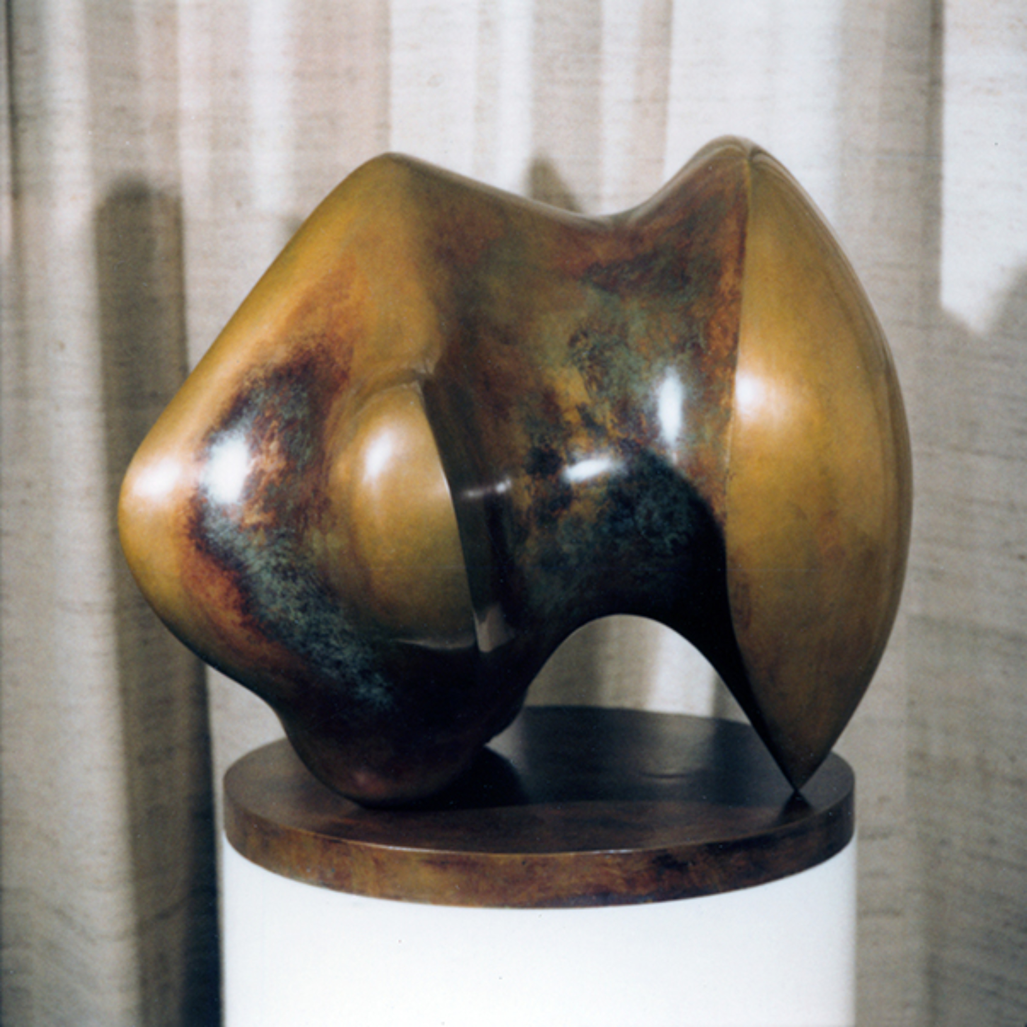 Three Way Piece No. 1: Points by Henry Moore is an abstract sculpture.