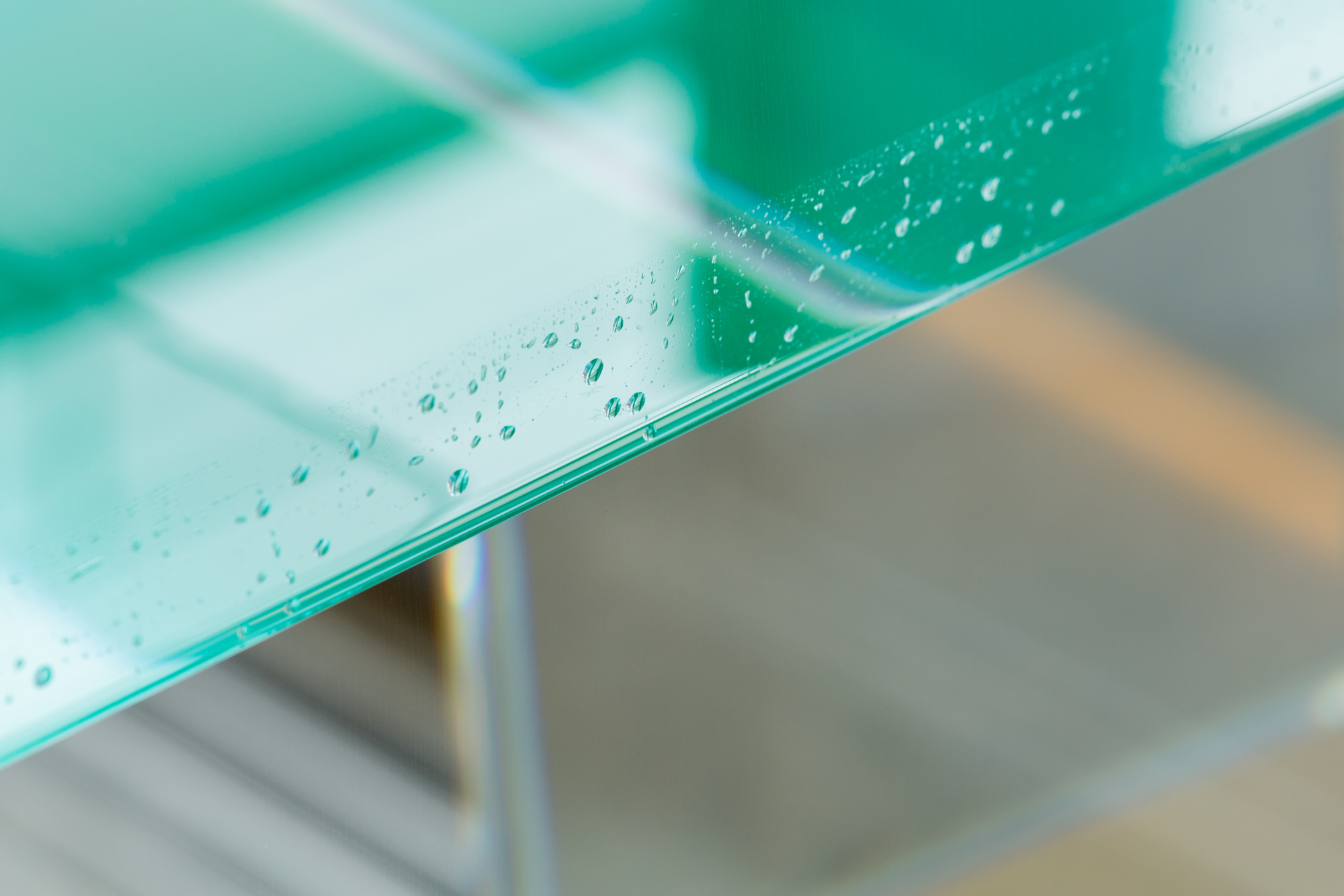 A glass cube filled with green paraffin oil