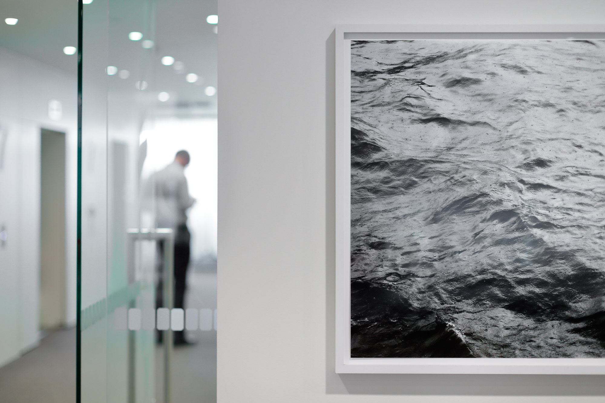 Color photograph of the water surface of the Thames River in London, by artist Roni Horn.